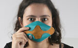 Yael Mordechay models her technology-driven, stylish mask made during a Bezalel Academy class project earlier this year (Courtesy Yael Mordechay)