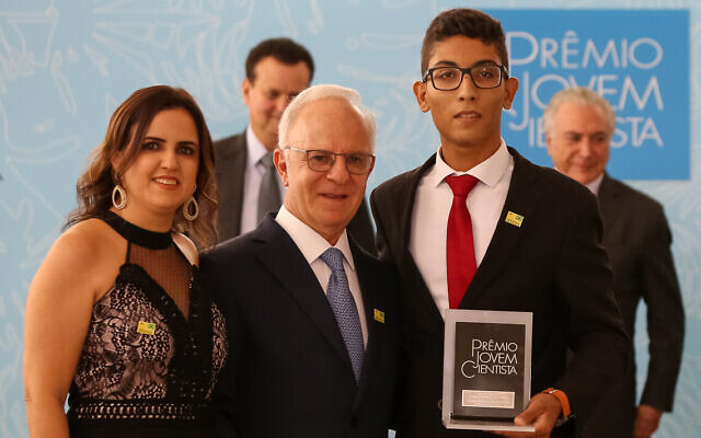 Miguel Krigsner, center, at a ceremony on December 5, 2018. (CC-BY-2.0/ Michel Temer)