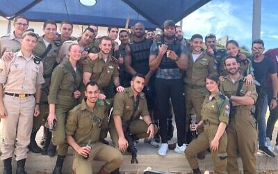 One-time Washington Redskins teammates Adrian Peterson and Josh Norman ran obstacle courses with Israeli soldiers and took Krav Maga lessons while on a visit to Israel. (IDF Twitter via JTA)