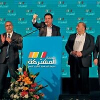 Ayman Odeh (C), leader of the Hadash party that is part of the Joint List alliance, gives an address with other alliance leaders at their electoral headquarters in Israel's northern city of Shefa Amr on March 2, 2020 Ahmad GHARABLI / AFP)