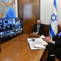 Prime Minister Benjamin Netanyahu (R) holds the weekly cabinet meeting via video conference call from the Prime Minister's Office in Jerusalem due to coronavirus regulations, March 15, 2020. (Haim Zach/GPO)