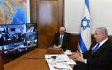 Prime Minister Benjamin Netanyahu (R) holds the weekly cabinet meeting via videoconference call from the Prime Minister's Office in Jerusalem due to coronavirus regulations, March 15, 2020. (Haim Zach/GPO)