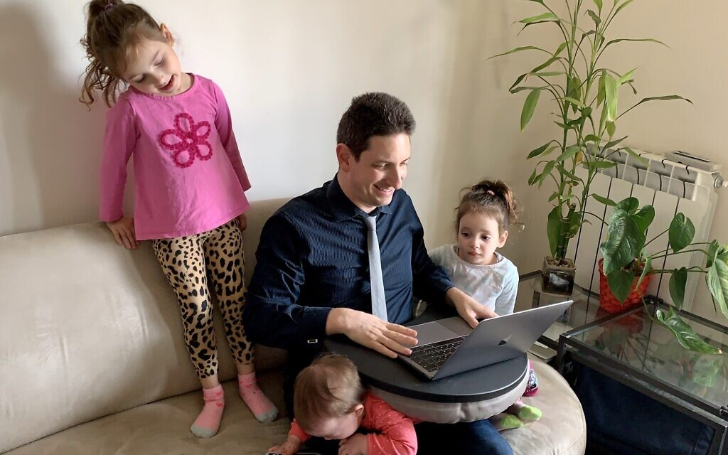 Eliav Rodman, chief marketing officer of myInterview, working from home surrounded by his three children in Jerusalem; March 26, 2020 (Maor Rodman)