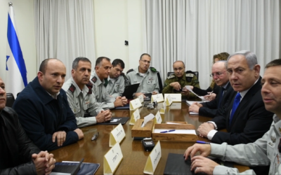 Prime Minister Benjamin Netanyahu, Defense Minister Naftali Bennett and senior officials from Israel's security services, including Maj. Gen. Aharon Haliva, center-left,  meet to discuss growing tensions with terror groups in the Gaza Strip at the military's Tel Aviv headquarters on February 23, 2020. (Tal Oz/Defense Ministry)