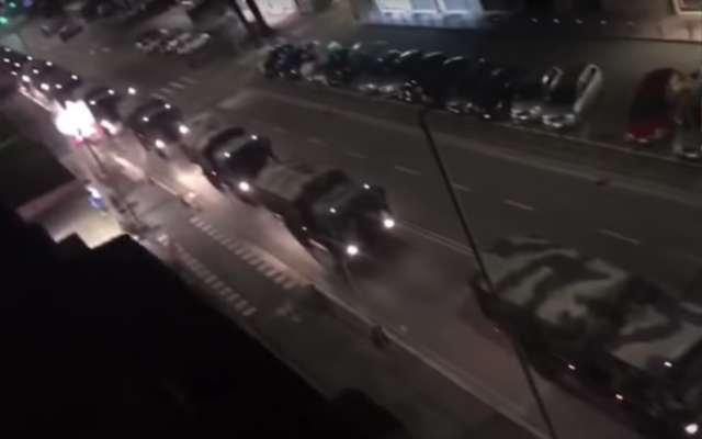 A convoy of Italian military vehicles reportedly being used to transport bodies of coronavirus fatalities for burial, March 19, 2020 (Youtube screenshot)
