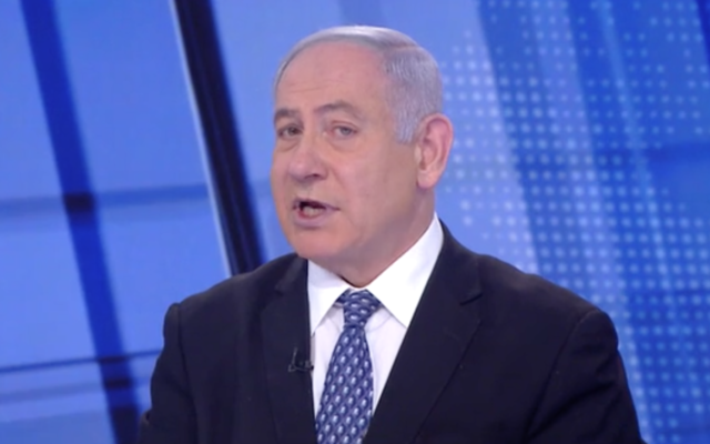 Prime Minister Benjamin Netanyahu in a Channel 12 interview, March 21, 2020 (Screenshot)