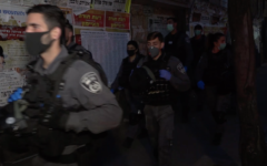 Israel Police officers enter Jerusalem's Mea Shearim neighborhood to enforce the government's anti-coronavirus restrictions on March 30, 2020. (Screen capture: Israel Police)