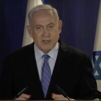 Prime Minister Benjamin Netanyahu delivers a televised statement at the Prime Minister's Residence in Jerusalem on March 30, 2020. (Screen capture/ YouTube)