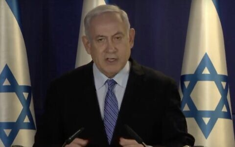 Prime Minister Benjamin Netanyahu delivers a televised statement at the Prime Minister's Residence in Jerusalem on March 30, 2020. (Screen capture/YouTube)