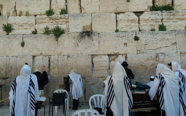 Morning prayers at the Western Wall in Jerusalem's Old City, March 16, 2020. (Courtesy: The Western Wall Heritage Foundation)