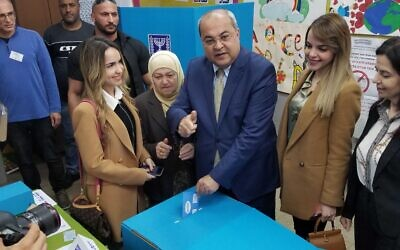 Joint List MK Ahmad Tibi voting in his hometown Taibe on March 2, 2020. (Adam Rasgon/Times of Israel)