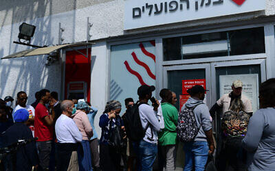 Israelis wait in line outside a bank near the Hatikva Market, Tel Aviv, March 15, 2020. (Tomer Neuberg/Flash90)