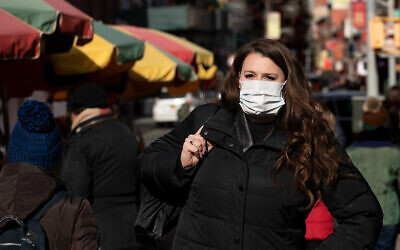A woman wears a mask amid coronavirus fears in New York, Jan. 30, 2020. (AP/Mark Lennihan)