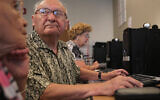 Residents learn how to use Facebook at the Jewish Community Housing for the Elderly in Massachusetts. (Suzanne Kreiter/Getty Images)
