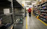 Empty shelves at a supermarket in Jerusalem, March 14, 2020. (Yossi Zamir/Flash90)