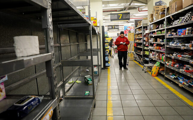 Empty shelves at a supermarket in Jerusalem, March 14, 2020. (Yossi Zamir/Flash90)