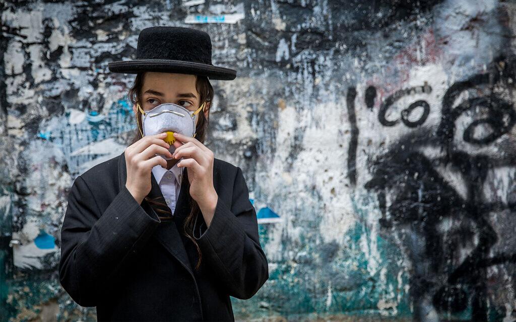 An ultra-Orthodox youth in Jerusalem, March 16, 2020. (Yonatan Sindel/Flash90)