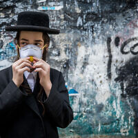 An ultra-Orthodox youth in Jerusalem, March 16, 2020. (Yonatan Sindel/Flash90)