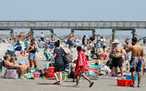 Despite warnings from government officials to take caution and self distance because of the coronavirus, beach goers enjoy the Isle of Palms beach in South Carolina, March 20, 2020. (AP/Mic Smith)