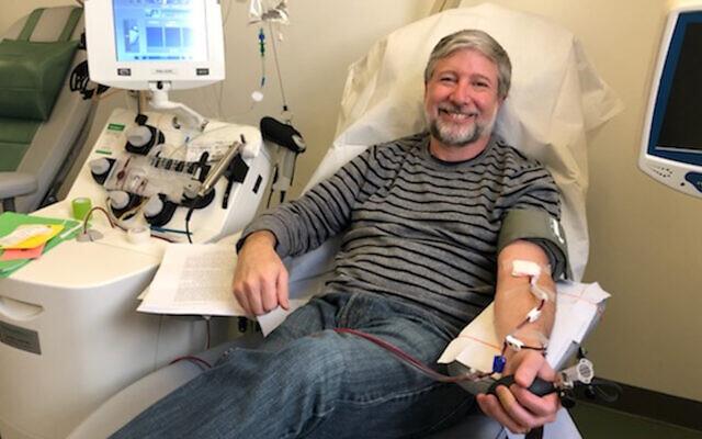 Rabbi Daniel Nevins donating blood plasma at Mount Sinai Hospital in New York, March 27, 2020. (Courtesy/Daniel Nevins via JTA)
