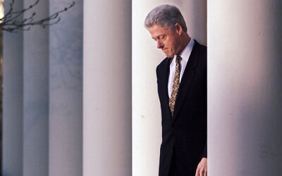 US President Bill Clinton walks to the podium to deliver a short statement on his impeachment at the White House in Washington, Dec. 11, 1998. (AP Photo/J. Scott Applewhite)
