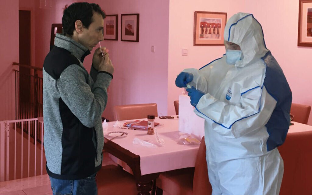 The author is tested for coronavirus while under quarantine in Israel. (Courtesy/Uriel Heilman)