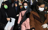 People wearing face masks in downtown Tehran, Iran, March 2, 2020. (AP/Vahid Salemi)