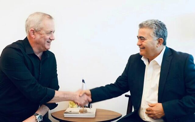Blue and White leader Benny Gantz, left, and Labor party leader Amir Peretz meet to discuss coalition talks, on March 11, 2020. (Blue and White/Elad Malka)