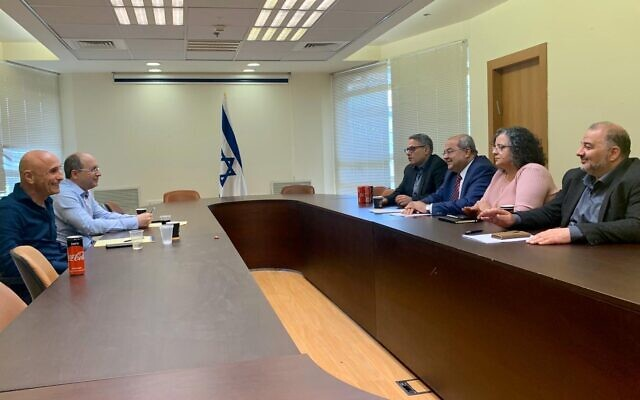 Blue and White MKs Ofer Shelah (L) and Avi Nissenkorn hold talks with Joint List MKS Mtanes Shihadeh, Ahmad Tibi, Aida Touma-Sliman and Mansour Abbas in the Knesset on March 11, 2020. (Courtesy)