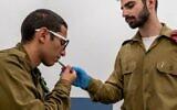 An IDF soldier has his temperature checked. (Photo: IDF Spokesperson's Unit)