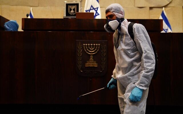 A worker disinfecting the Knesset on March 15, 2020. (Adine Wolman/Knesset Spokesperson's Office)