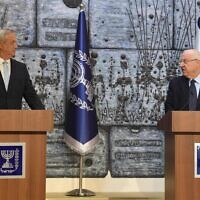 President Reuven Rivlin (R) tasks Blue and White chairman Benny Gantz with forming a government in a ceremony at the President's Residence in Jerusalem on March 16, 2020. (Mark Neyman/GPO)