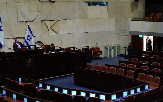 MKs vote on-by-one in the Knesset plenary to form four committees including the Coronavirus Committee, March 24, 2020. (Adina Veldman/Knesset)