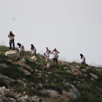 Settlers from Homesh hurl stones at Palestinians on March 26, 2020. (Yesh Din)