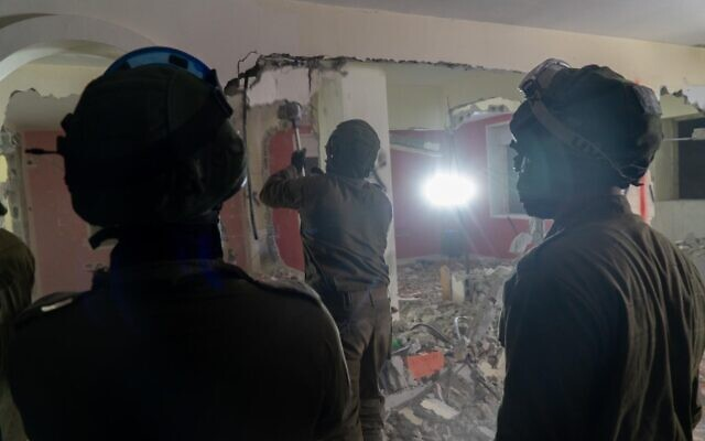 Israeli troops demolish the home of one of the terrorists involved in a bombing attack that killed Rina Shnerb, 17, at a natural spring in the West Bank last year, in the Ramallah area on March 4, 2020. (Israel Defense Forces)