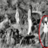 A person films Israel from the buffer zone between Syria and Israel in what the IDF says was an effort to prepare for a sniper attack, as seen in a surveillance photo released by the military on March 17, 2020. (Israel Defense Forces)