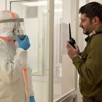 Israeli troops operate a laboratory to test soldiers for the coronavirus on March 23, 2020. (Israel Defense Forces)