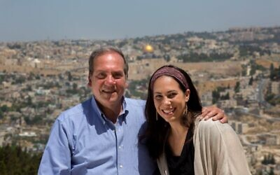 International Fellowship of Christians and Jews founder Rabbi Yechiel Eckstein and daughter Yael, the current organization head, with a view of the Jerusalem Old City. (Olivier Fitusi)