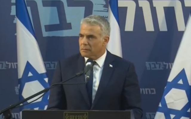 Yair Lapid holds a press conference in Tel Aviv, March 26, 2020 (screenshot)