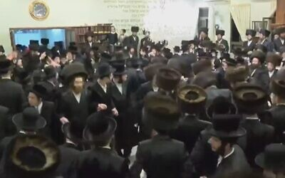 More than 150 ultra-Orthodox Jews defy Health Ministry coronavirus warnings and take part in a wedding in the city of Beit Shemesh on March 17, 2020 (Screen capture: Channel 12)