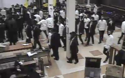 Followers of the Chabad movement dance on March 14, 2020, days before 770 Eastern Parkway's closure because of the coronavirus. (Youtube screenshot)