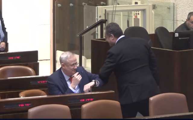 Benny Gantz (L) and Foreign Minister Israel Katz of Likud exchange an elbow bump in lieu of a handshake at the Knesset on March 26, 2020, during the vote on Gantz's election as Knesset speaker (video screenshot)