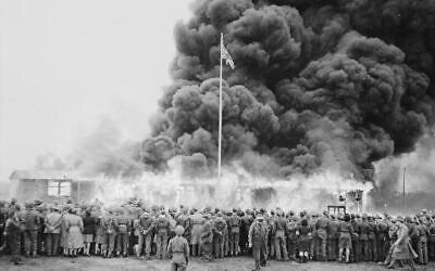 Ceremonial burning of last hut at Bergen-Belsen, Germany, 1945 (public domain)