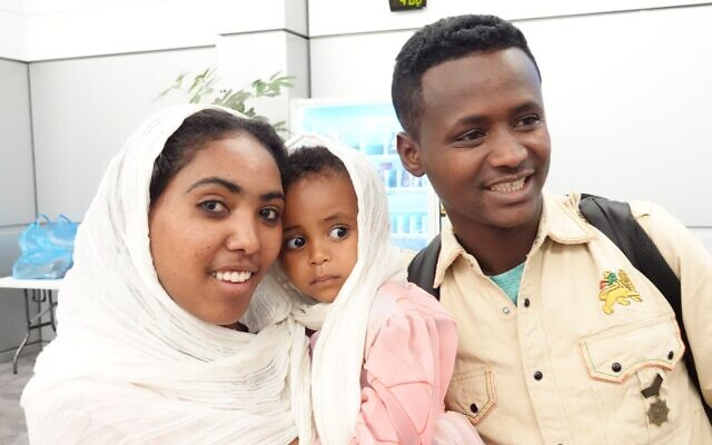 Ethiopian immigrants shortly after landing at Ben Gurion Airport, March 24, 2020. (Michael Dimenstein/ GPO)tein / GPO.