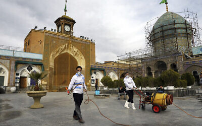 Workers disinfect the shrine of the Shiite Saint Imam Abdulazim to help prevent the spread of the new coronavirus in Shahr-e-Ray, south of Tehran, March, 7, 2020. (AP Photo/Ebrahim Noroozi)