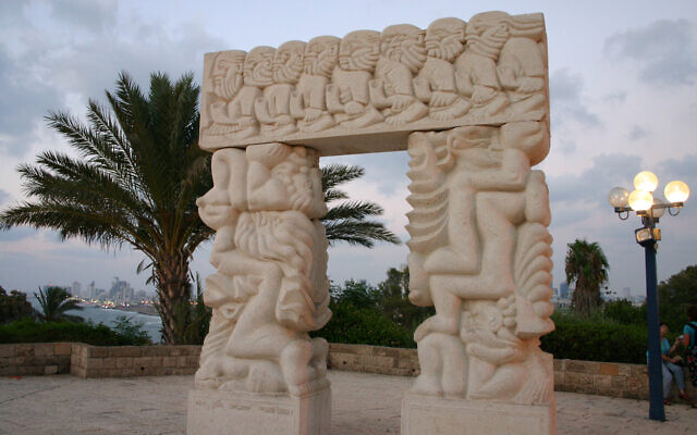 "The ""Gate of Faith"" in Old Jaffa's Abrasha Park, carved from Galilee stone, depicts the fall of Jericho, Jacob's Ladder and Isaac's Sacrifice. (Shmuel Bar-Am)"