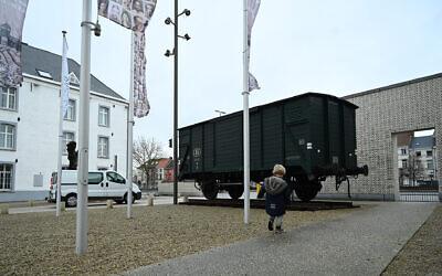 A boy visiting the Kazerne Dossin Holocaust museum in Mechelen, Belgium on December 22, 2019. (Cnaan Liphshiz/JTA)