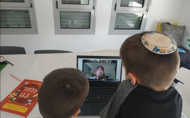Israeli preschool students engage in remote learning, March 16, 2020  (Israel Education Ministry Facebook page)