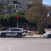 Police seen in Tel Aviv's Rabin Square on Saturday, March 21, 2020 (Channel 12 screenshot)