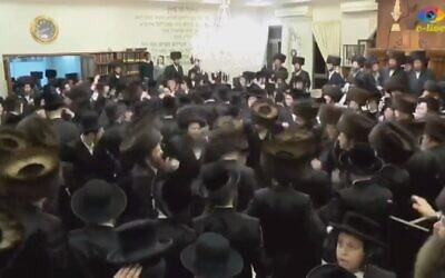 Ultra-Orthodox Israelis dance at a wedding in Beit Shemesh on March 18, 2020 (screenshot: Channel 12)